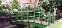 Bridge 12 - 10ft (3.04m) Japanese style bridge (with ball finials) painted green with boards stained Dark Oak. All components normally kept in stock.