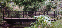 Bridge 15 - 19ft (5.79m) flat bridge - stained Dark Oak. Flat bridges look good over rivers, streams, gullies and ditches and are limited to 23ft 8in (7.20m). For ride-on mowers we would include a central beam or beams - prices on request.