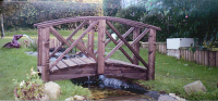 Bridge 9 - 5ft (1.52m) curved bridge (Chinese style) - stained Dark Oak- our shortest stock bridge. Finials extra if required. We keep beams from 3ft (91cms).